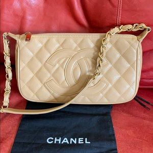 Authentic Chanel pochette in great condition!